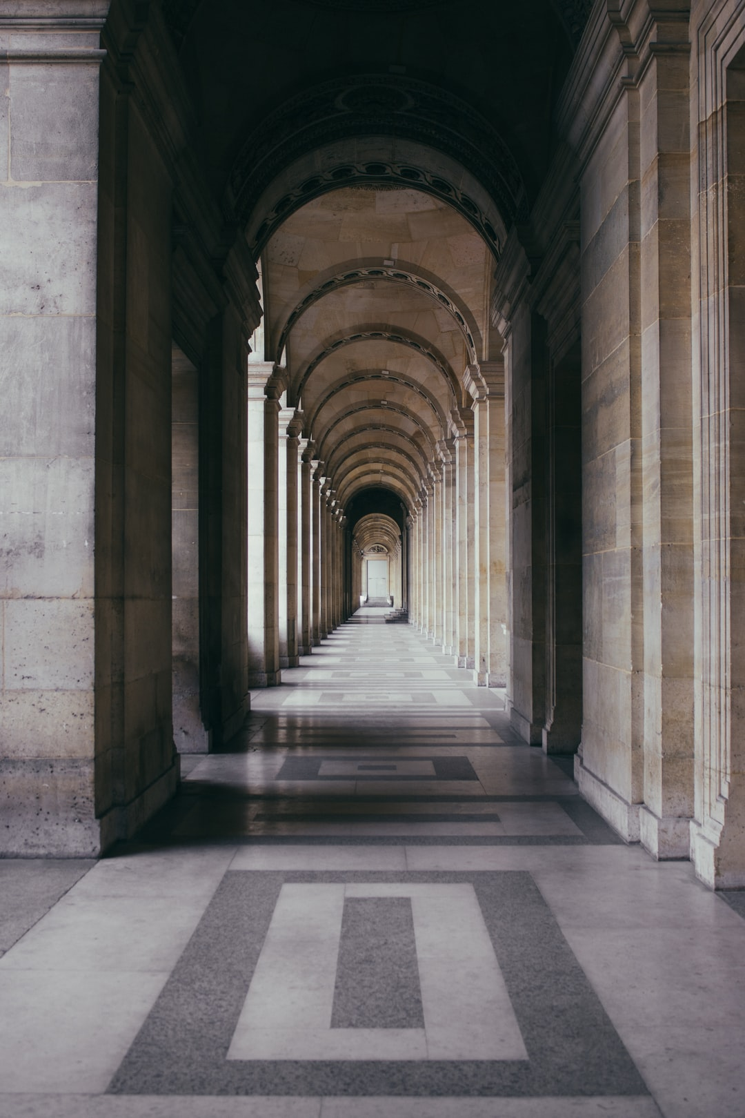 Hallway of marble arches