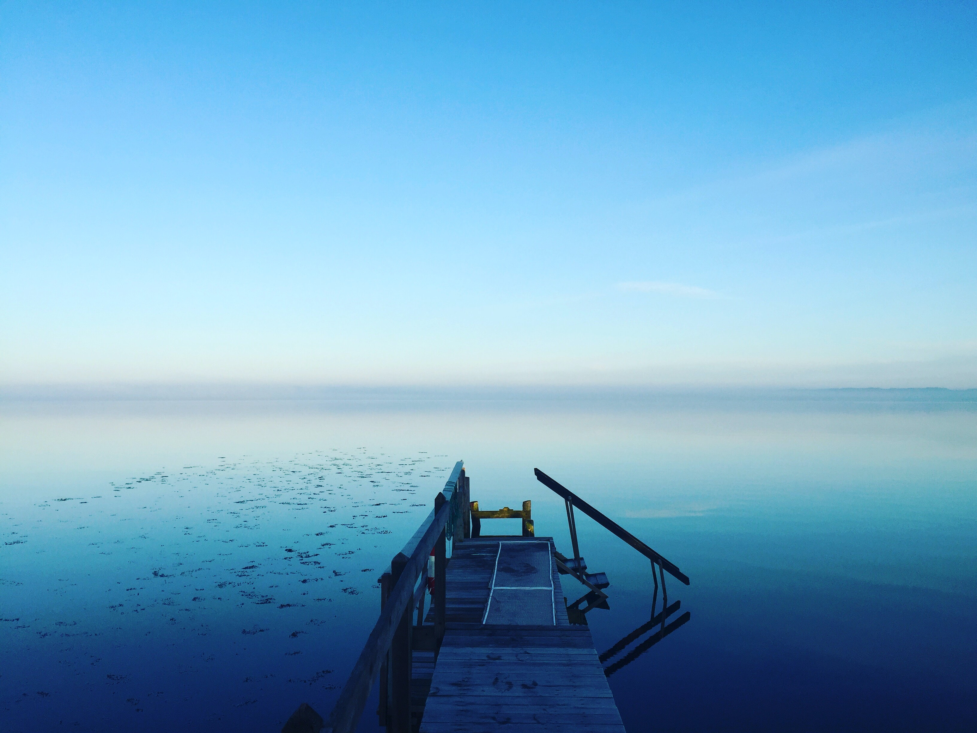 photography of calm body of water