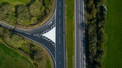 aerial view of gray concrete road near trees