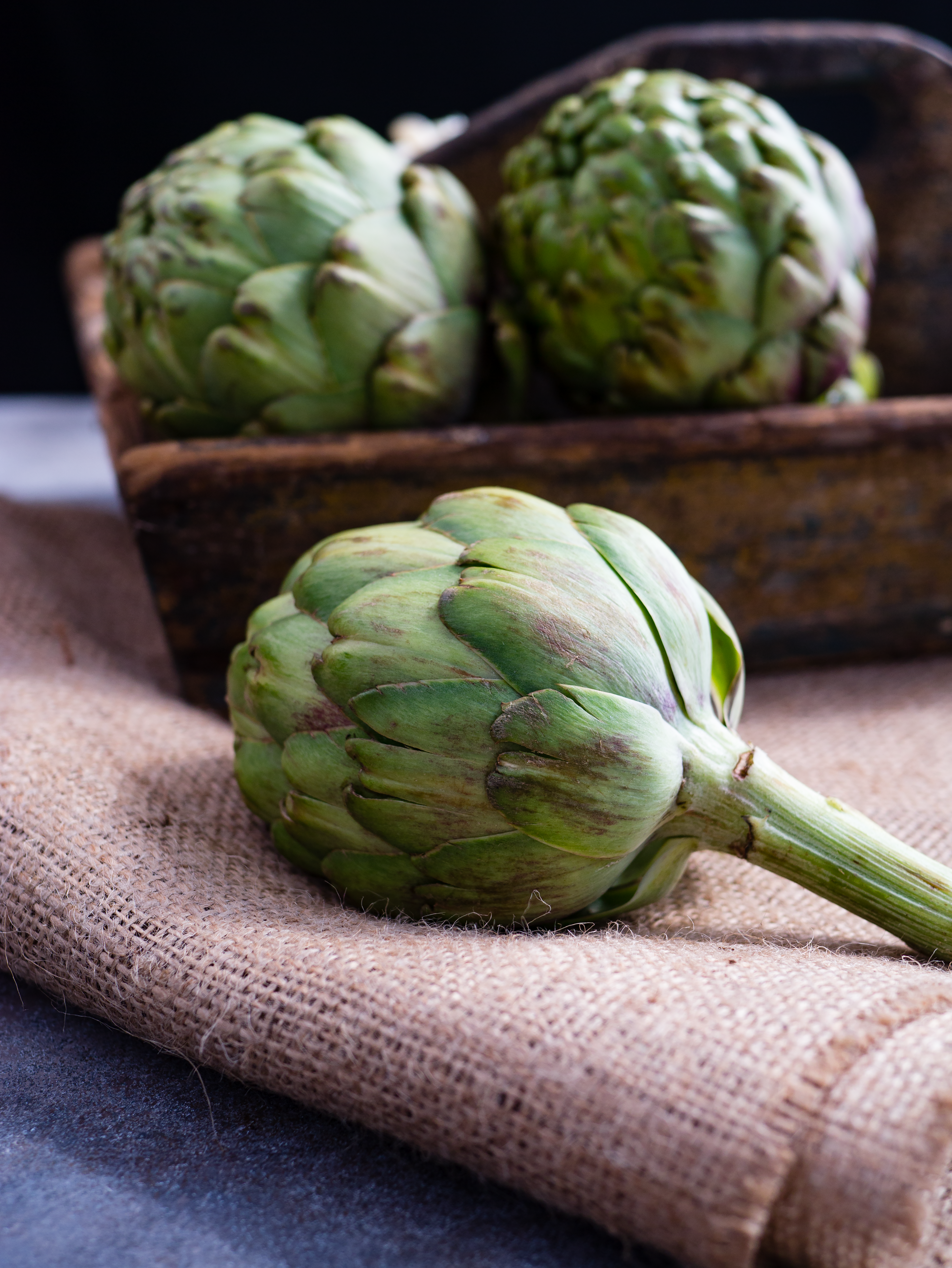 Fresh artichokes on a burlap cloth