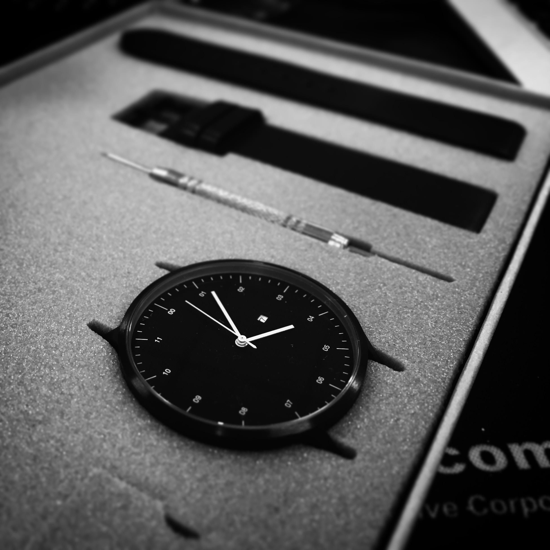black analog watch in black box