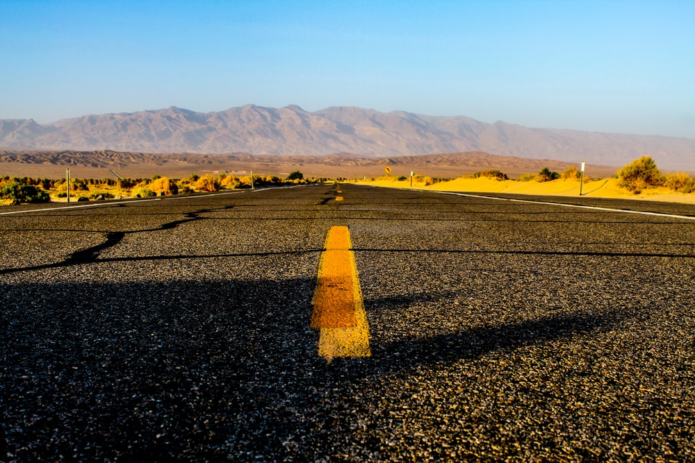 photography of black and yellow concrete road
