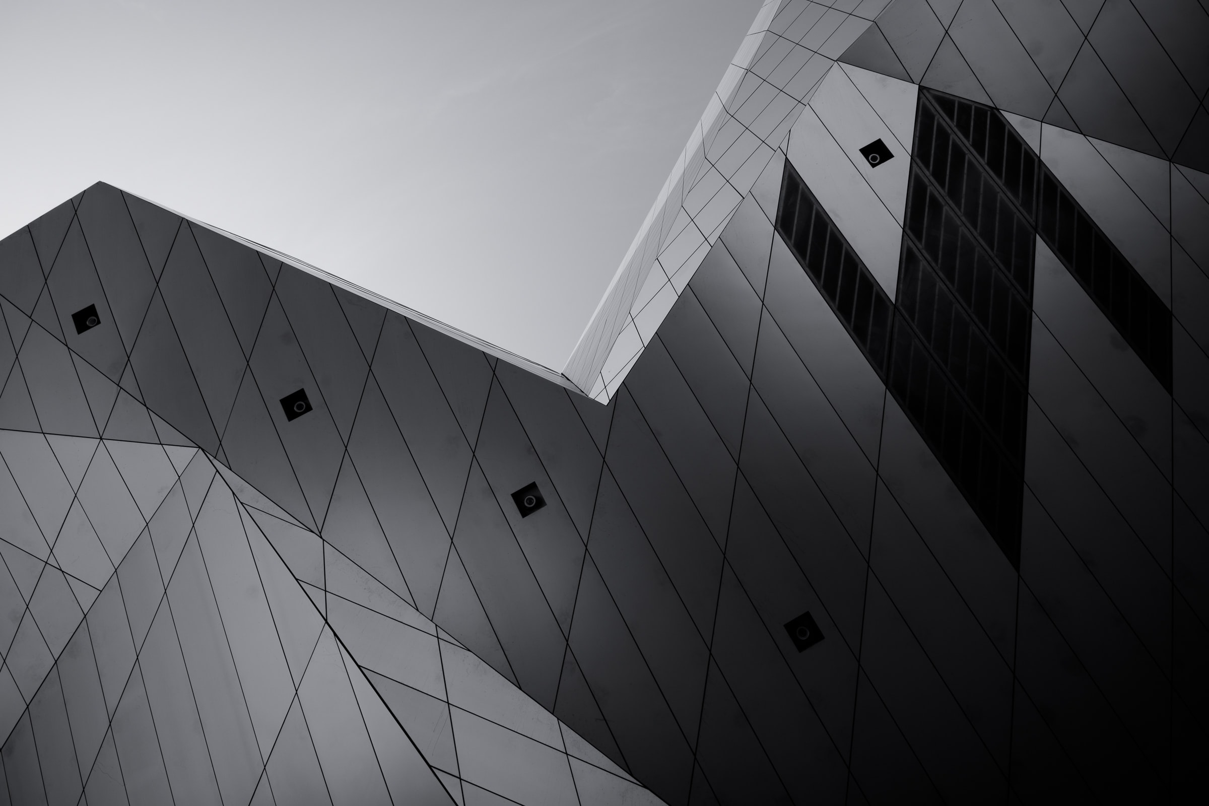 A low-angle shot of an overhang in a modern building facade
