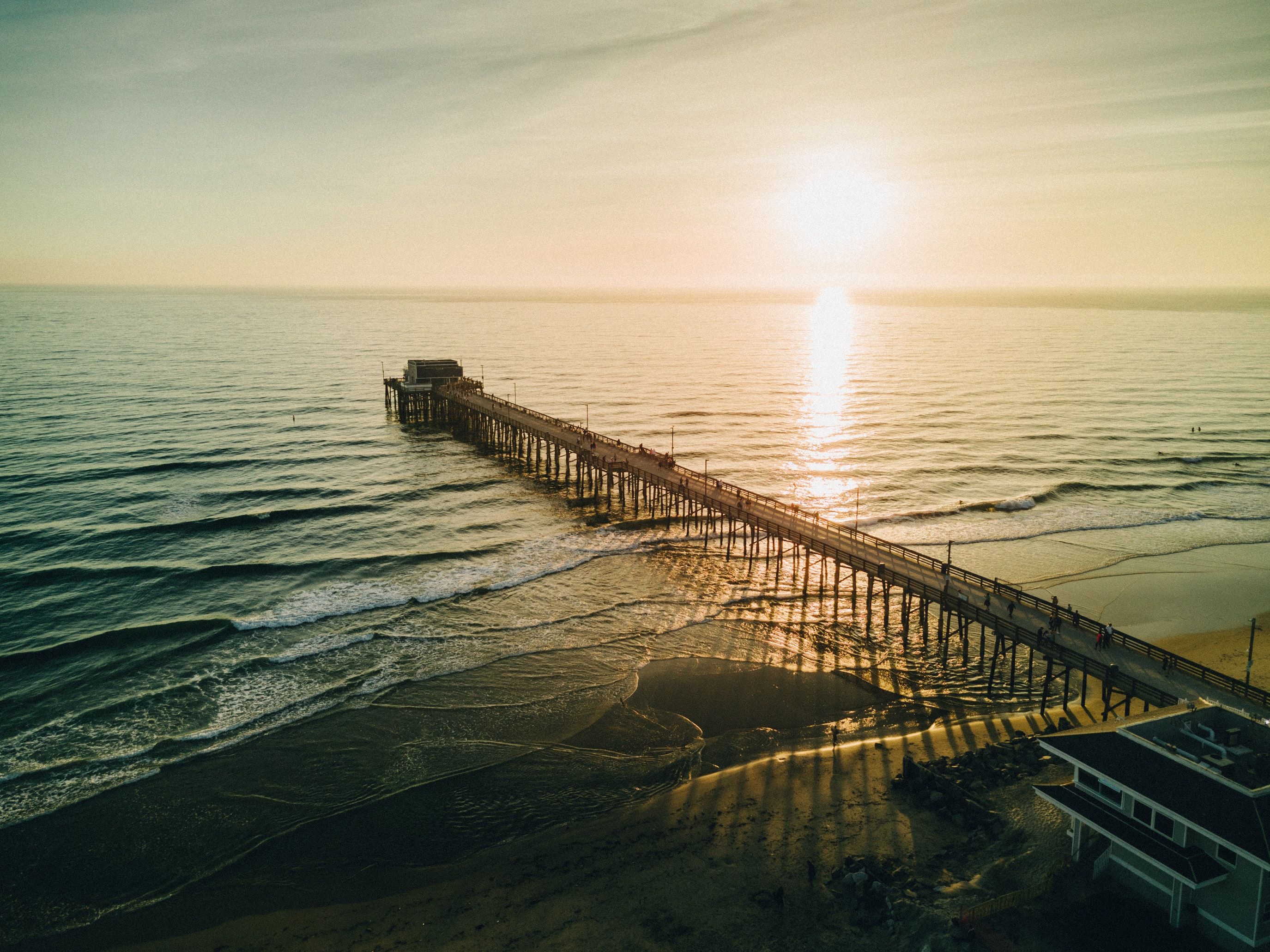 View of the long pier at the Newport Beach at sunset