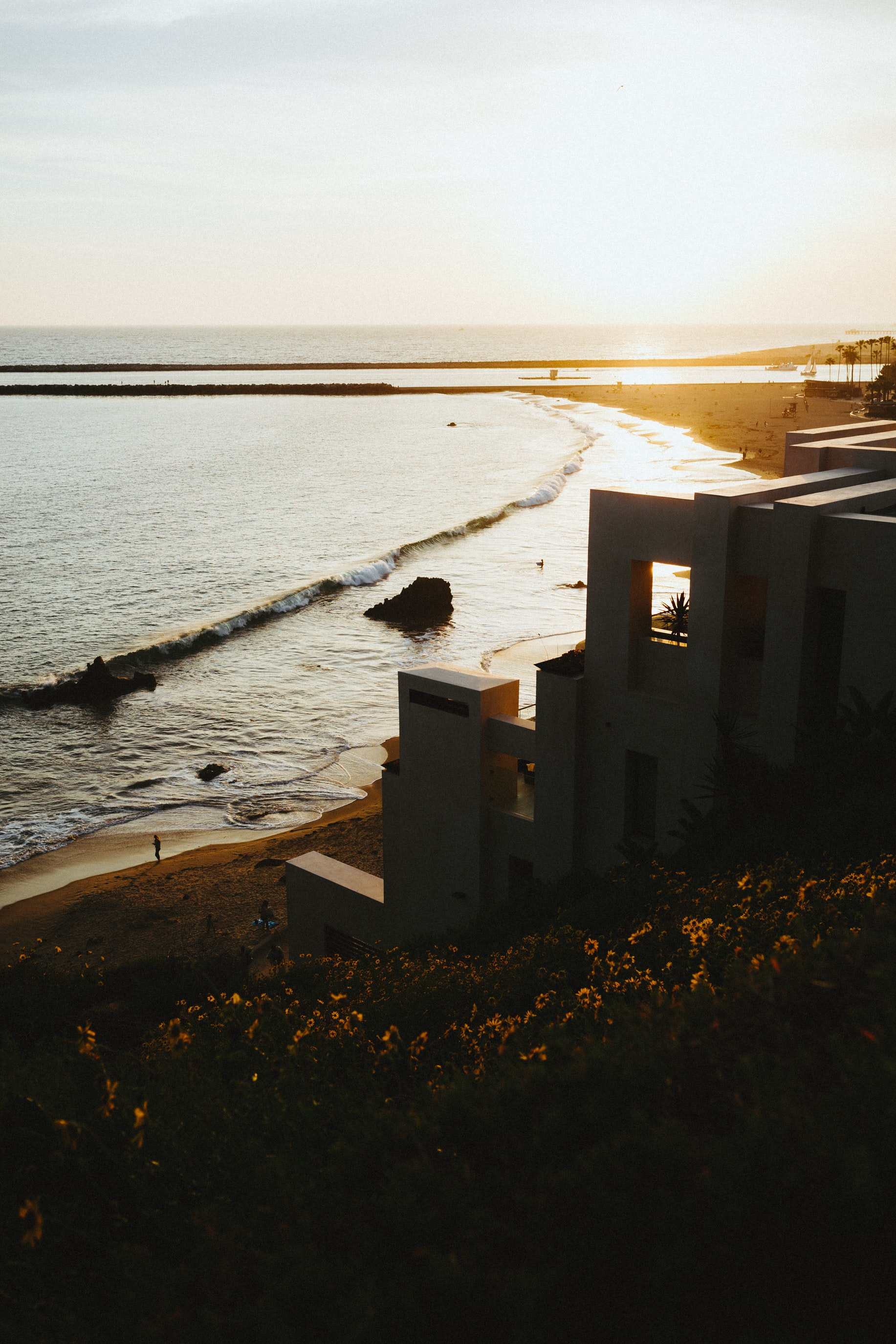House on the sandy beach coastline in Corona Del Mar at sunset