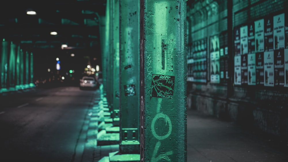 green steel fence near cars during daytime