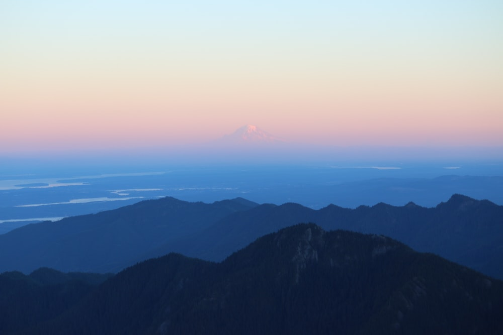 landscape photography of silhouette of mountains during daytime