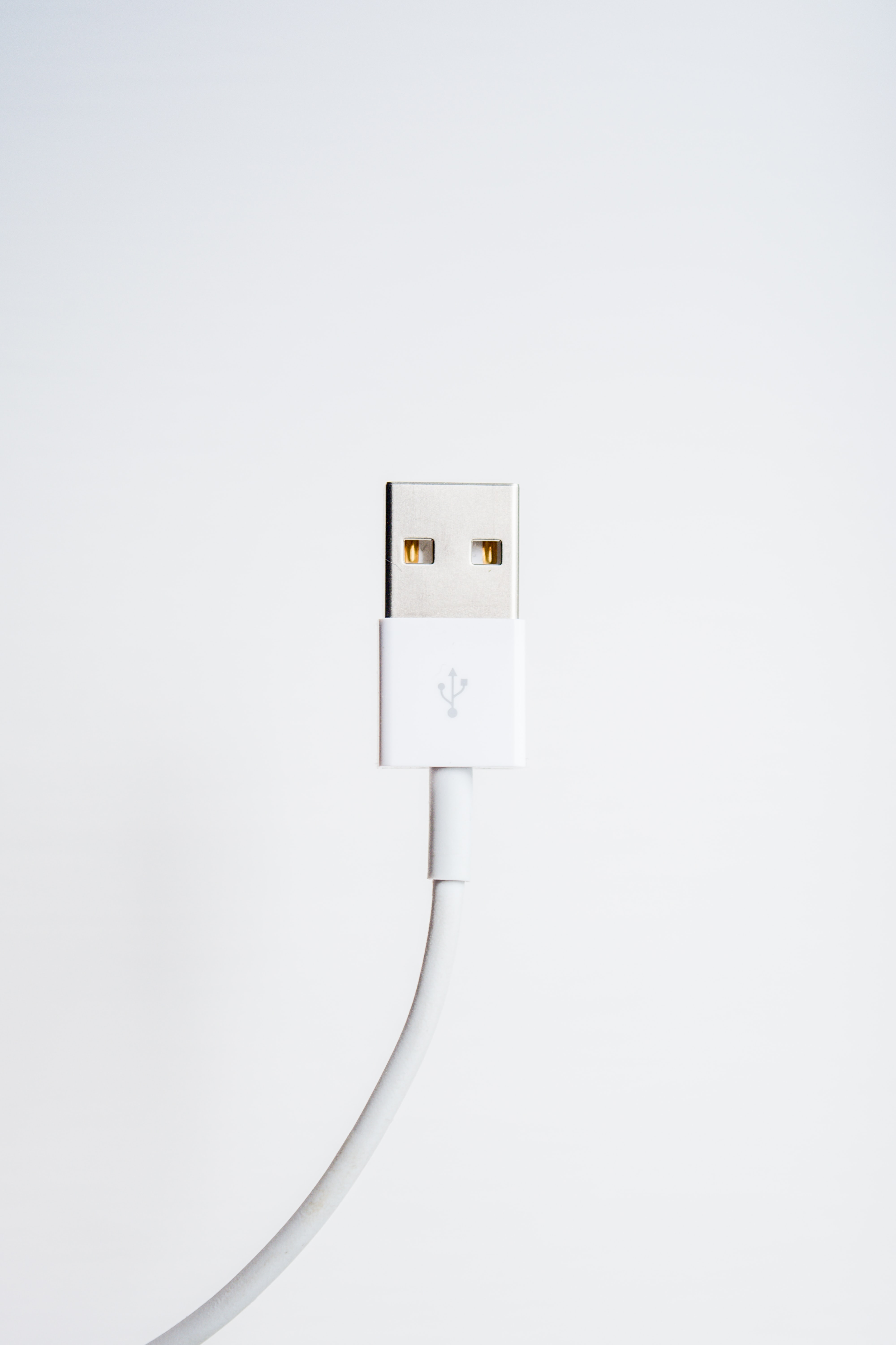 A white cable with an USB connector