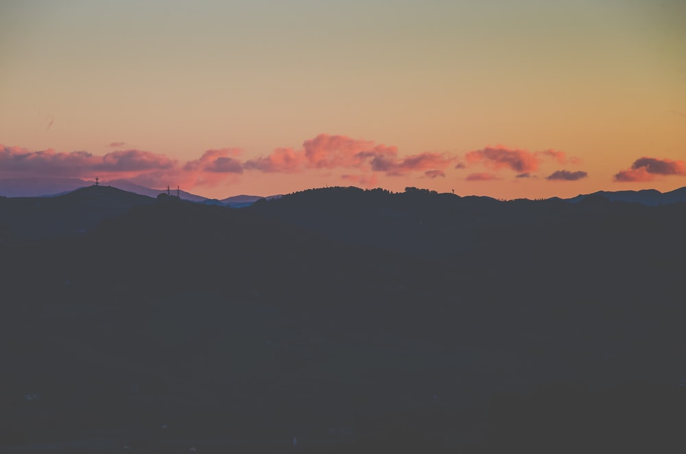 silhouette photography of highlands
