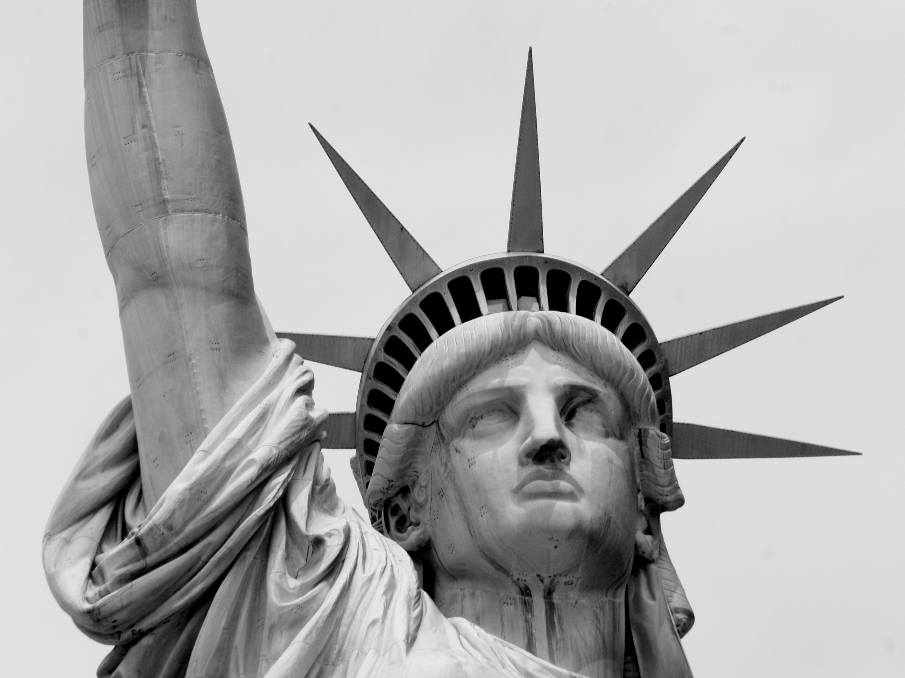 Black and white closeup photo of the Statue of Liberty's face