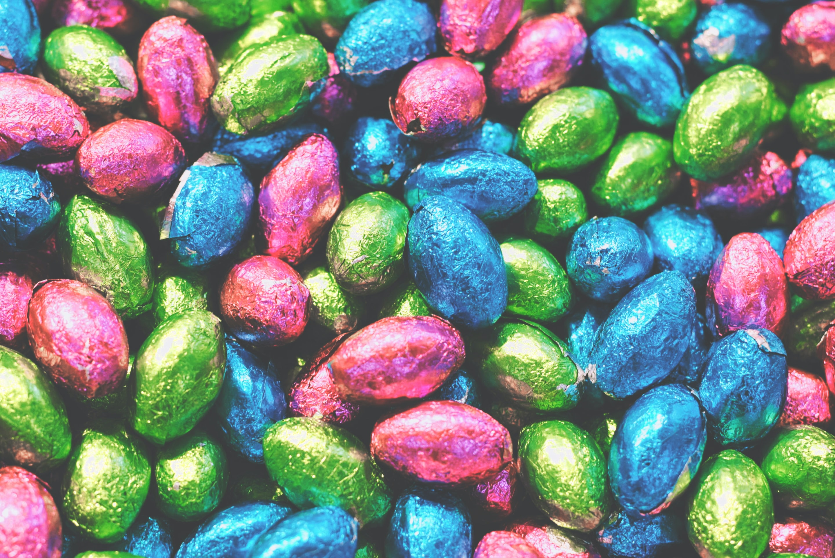 Pile of chocolate easter egg candy in colorful foil wrappers
