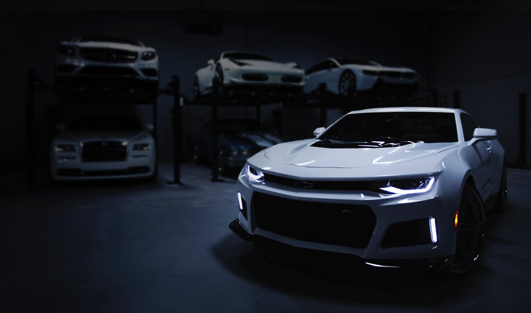 """I shot this while doing a job for a luxury automotive storage facility in Baltimore, MD. I wanted to create an ominous sense of intrigue, giving the feeling of a space that was both expansive and enclosed. I enjoy the journey my eyes take from the focal point of the headlamps to the contours of the Camero\u2019s body, and then to the backdrop of stacked automobiles."""