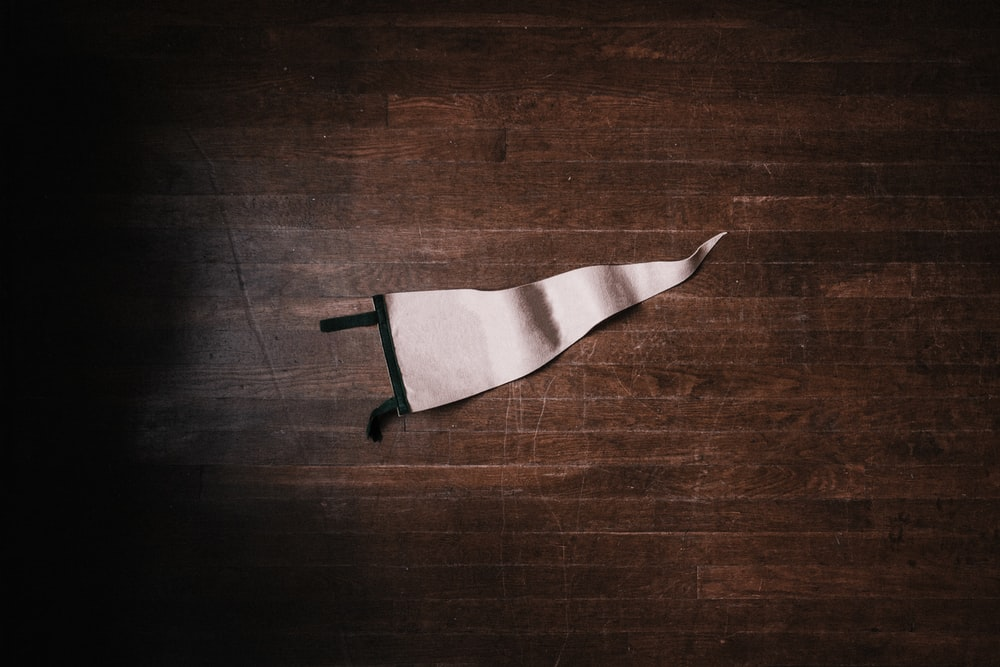 white pennant on brown surface