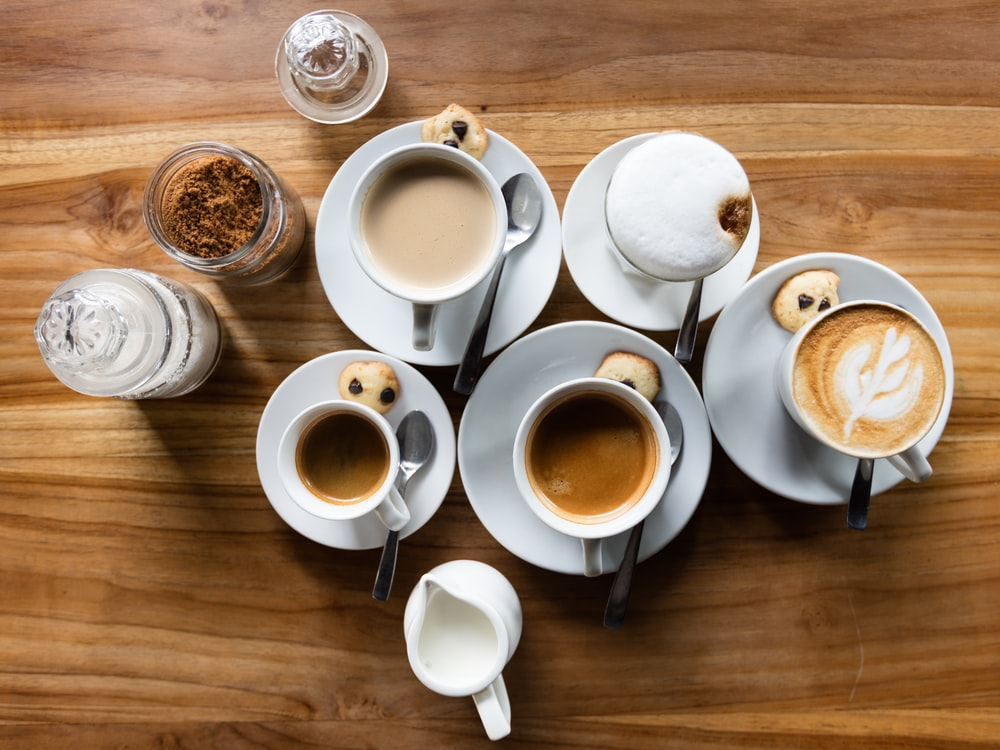 flatlay photography of five latte cups