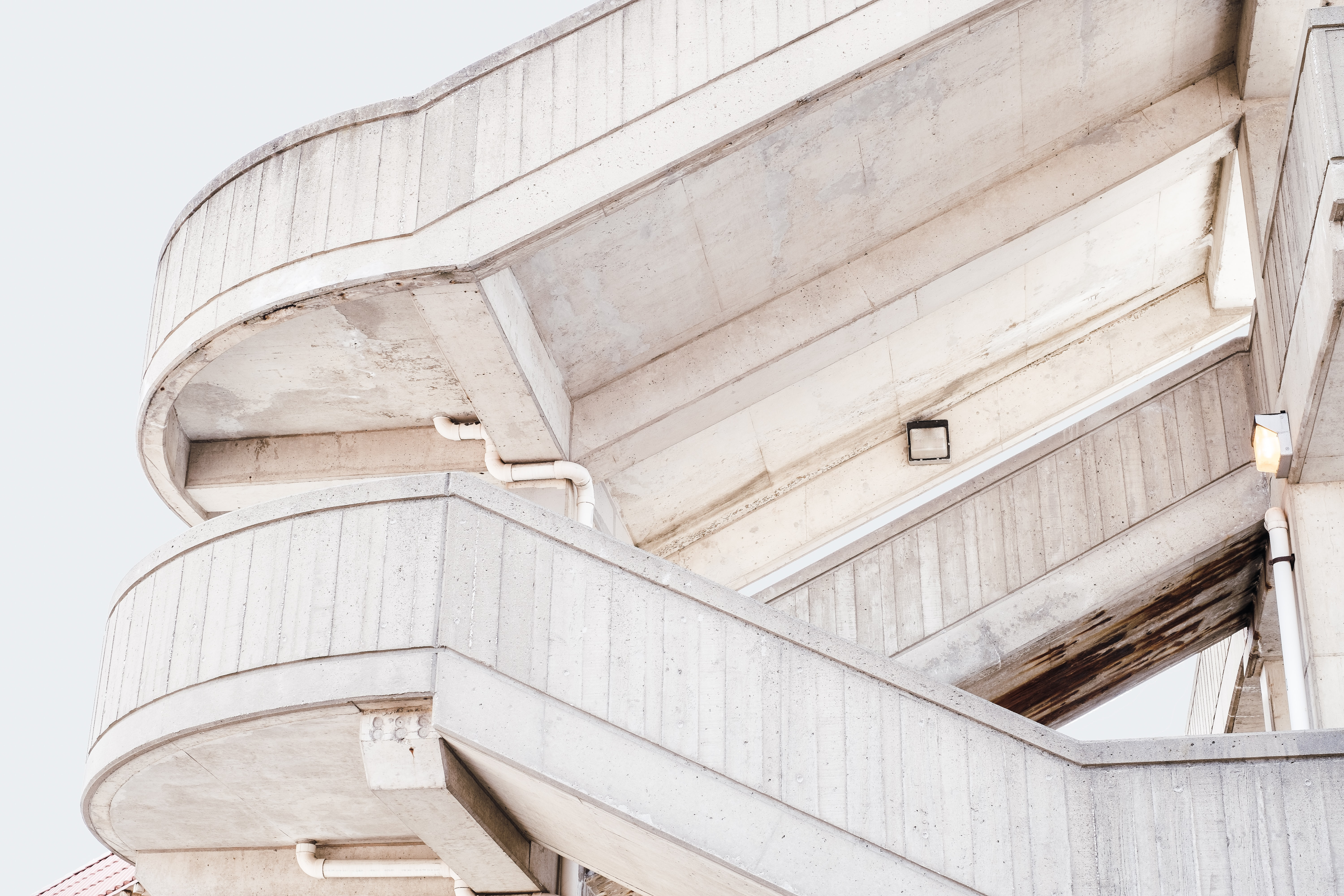 beige concrete stairs with white skies background