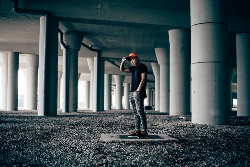 man standing on gray concrete floor