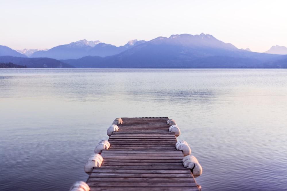 brown wooden boat dock in gray skies background