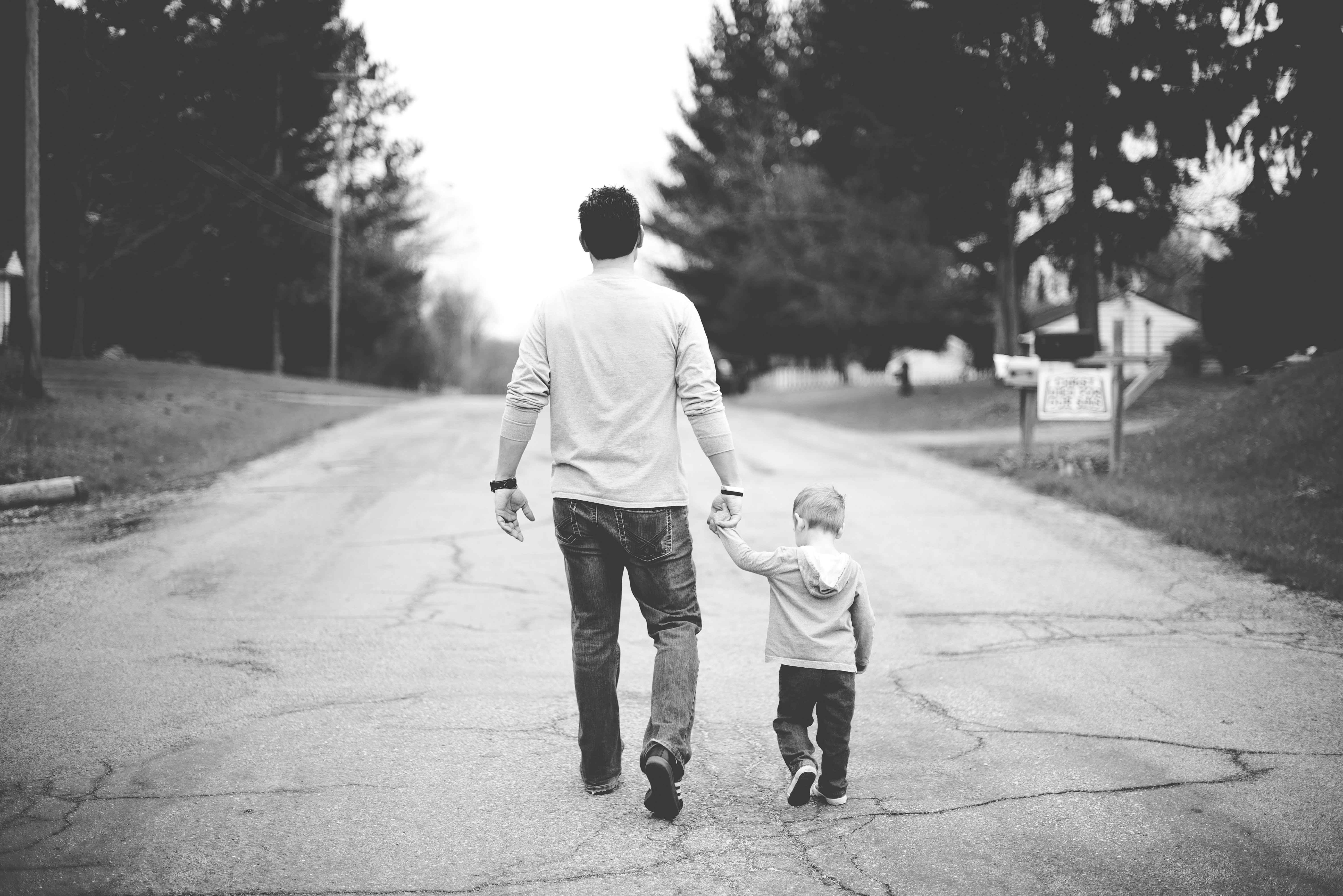 A dad walking with his toddler.