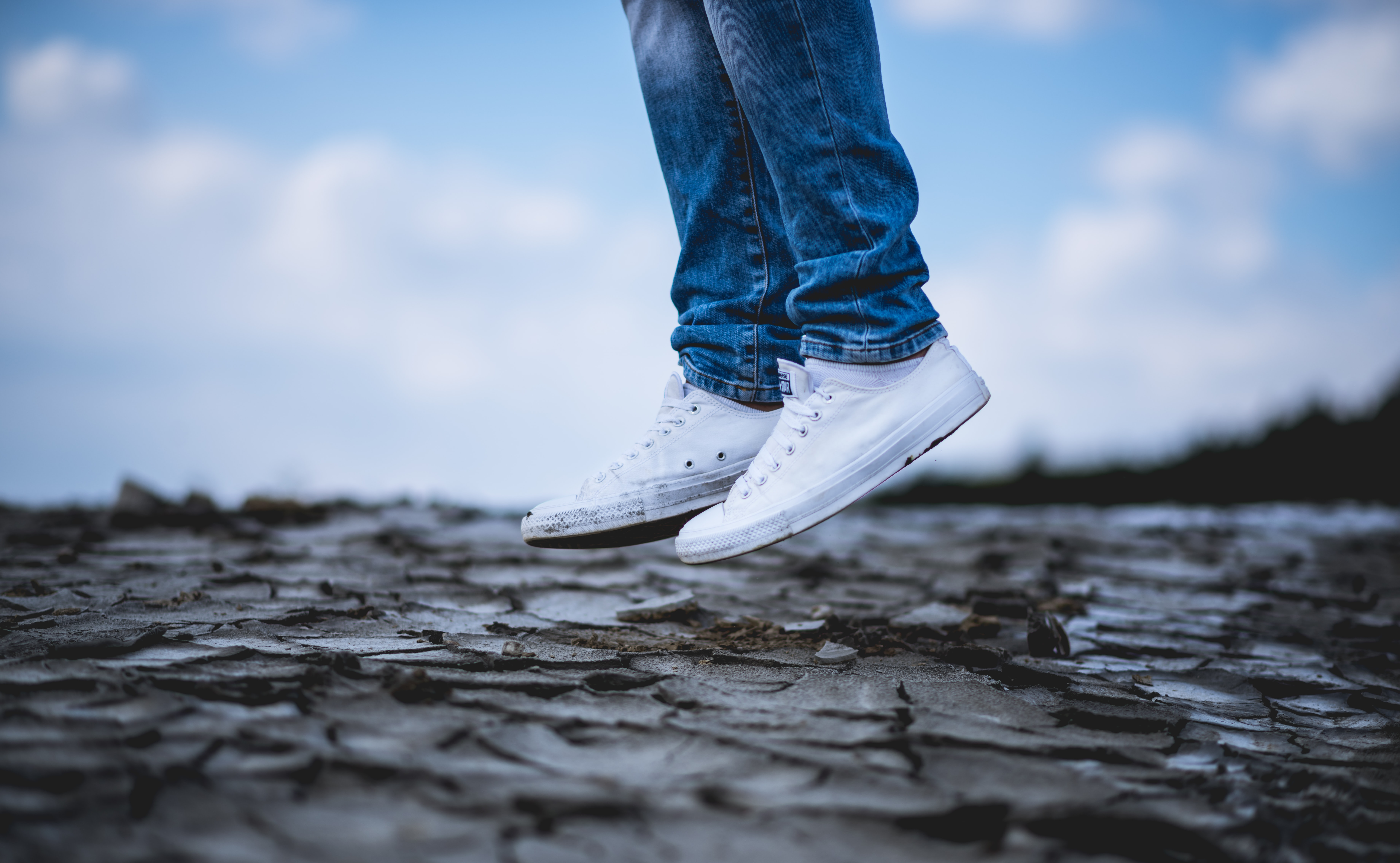person wearing white low-top sneakers