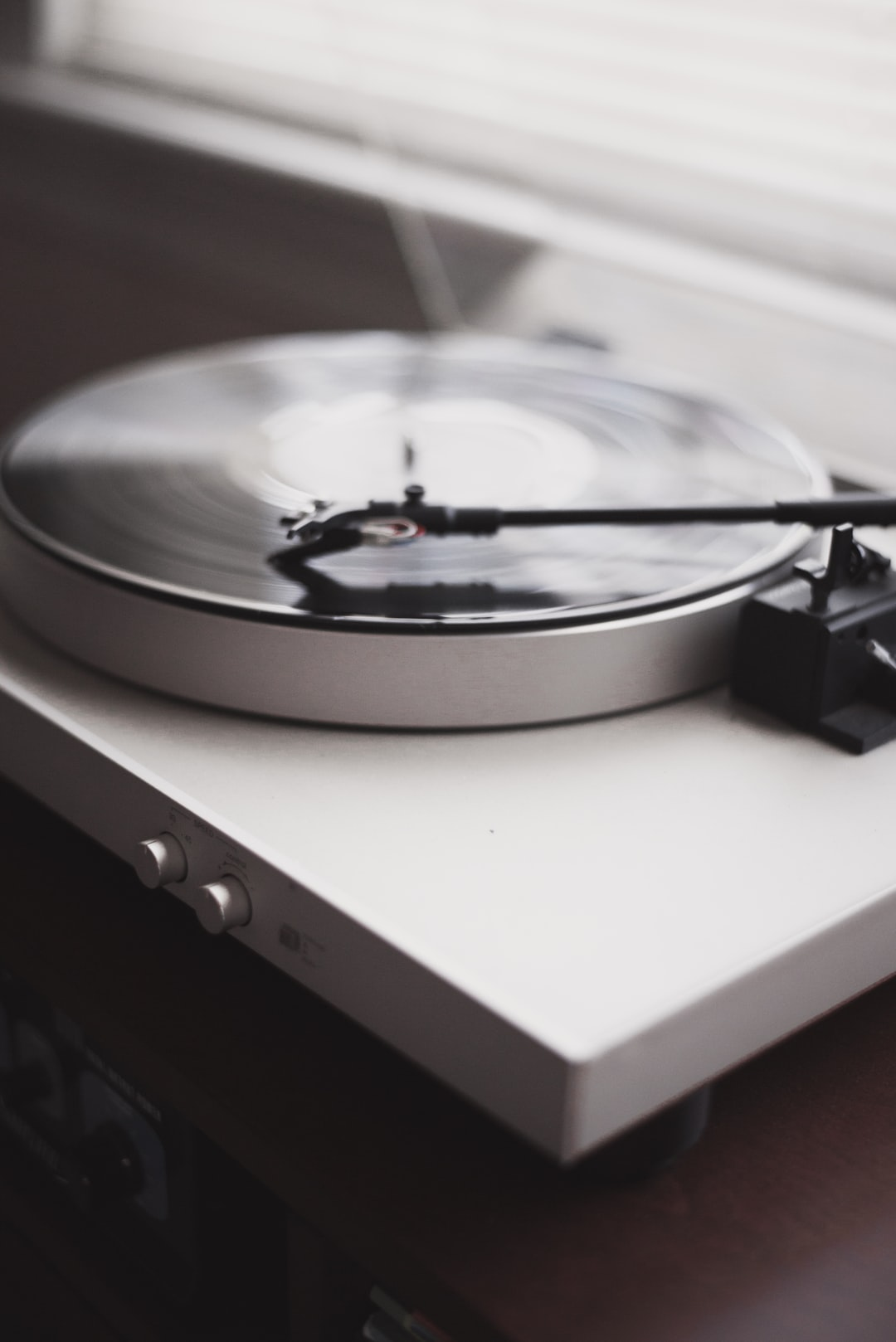 White turntable playing music