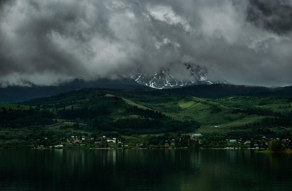 landscape photography of city and black sky