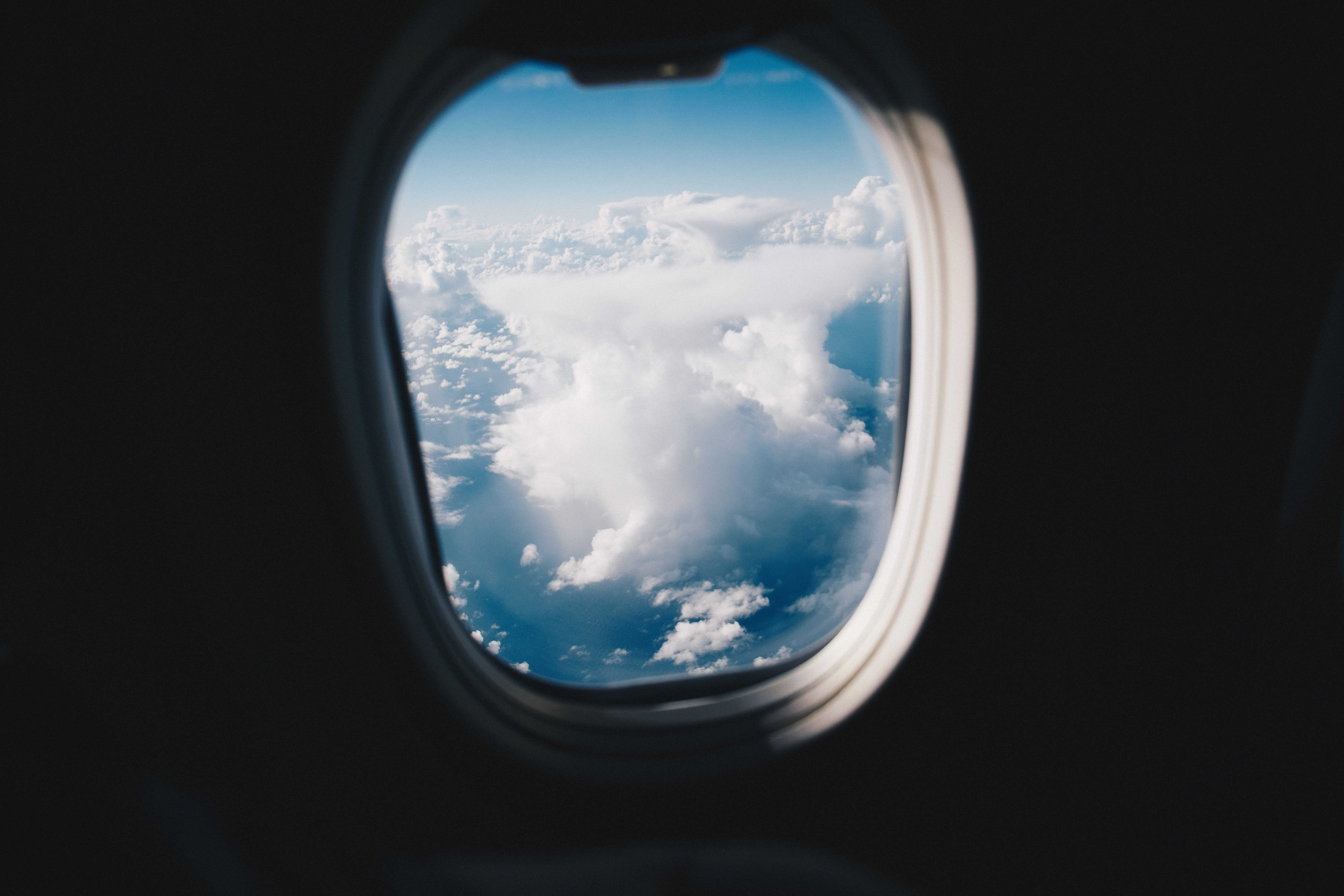 A view from an airplane window on high clouds over the Tasman Sea