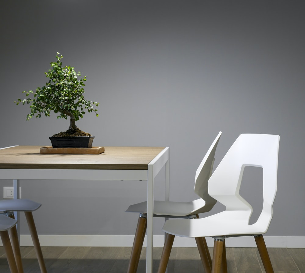 white and brown wooden table and chair set