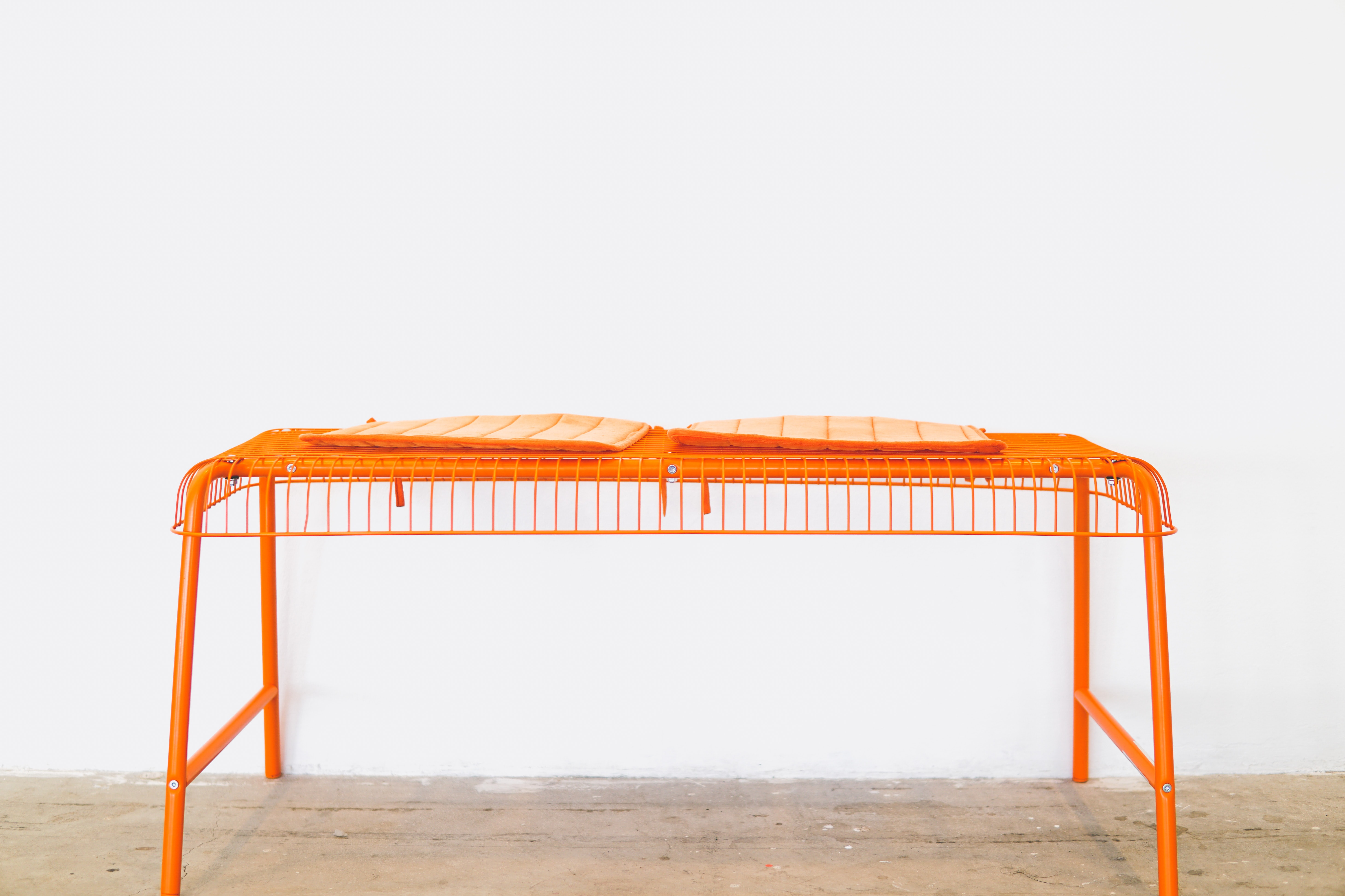 orange steel scaffolding on brown surface