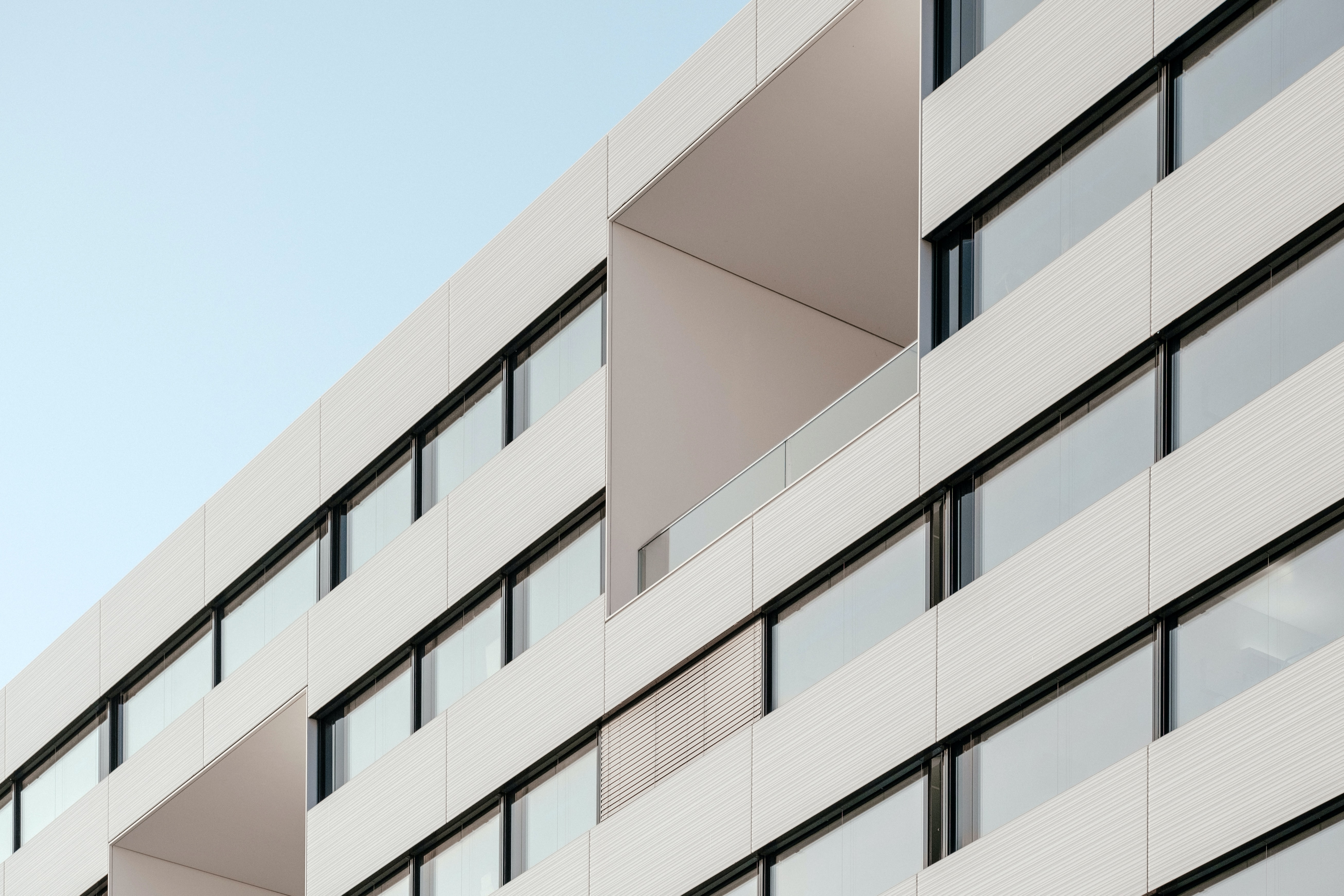 The facade of a residential building with large balconies