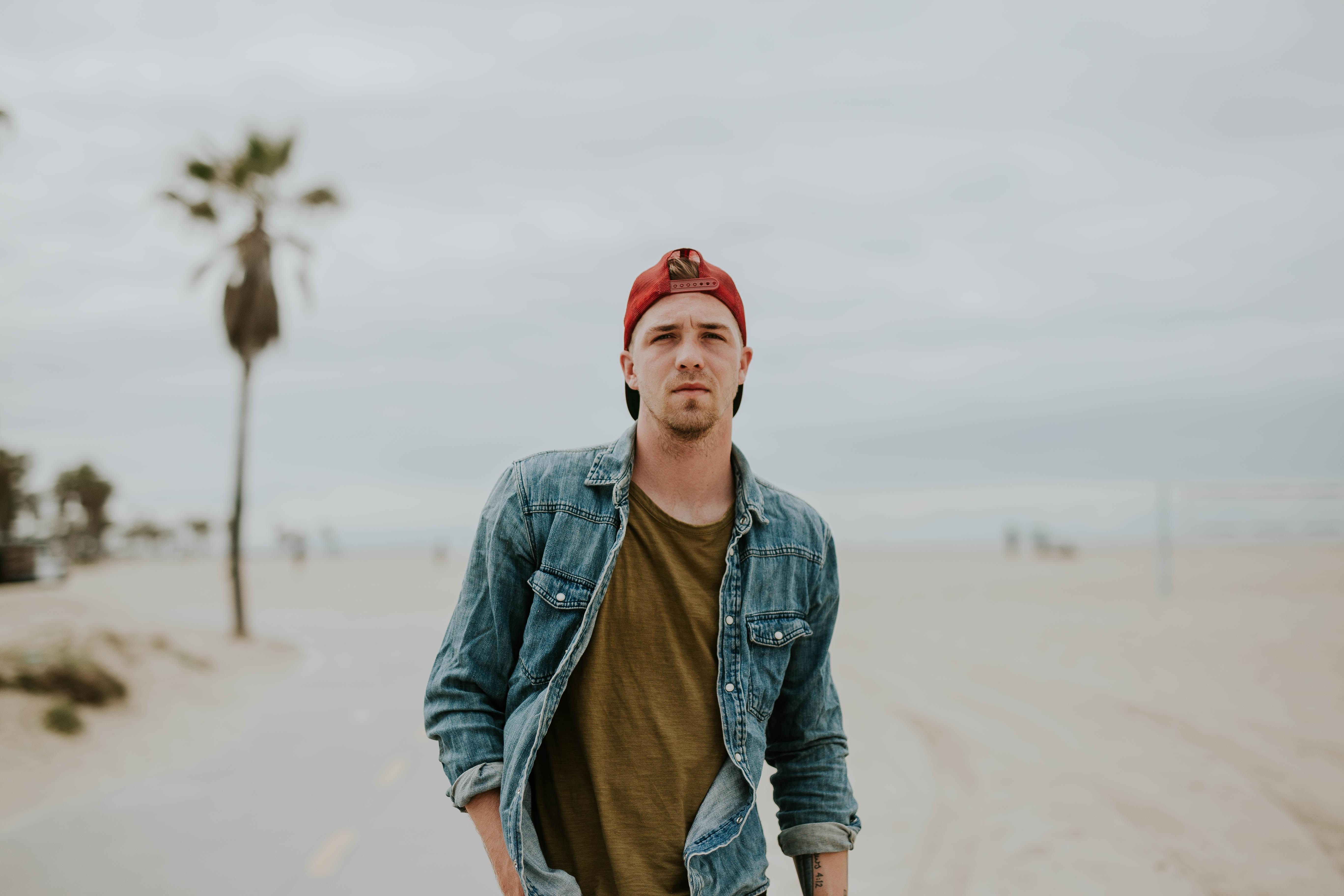 Portrait of a man in denim jacket posing at Venice Beach