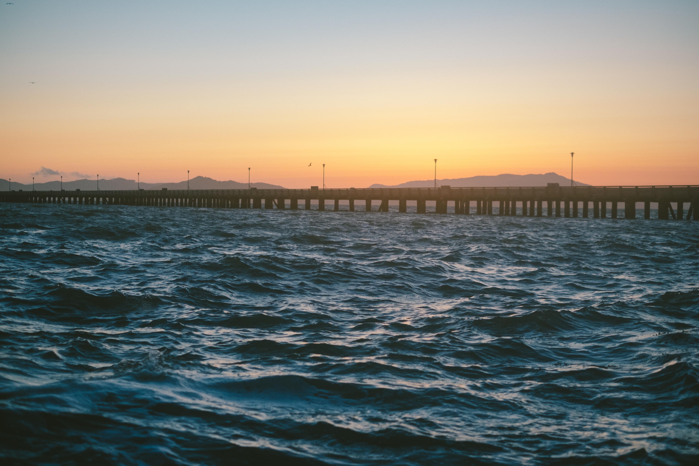 concrete bridge on body of water
