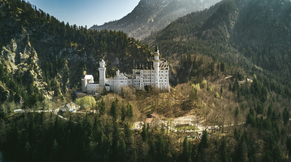 landscape photo of castle near the mountain
