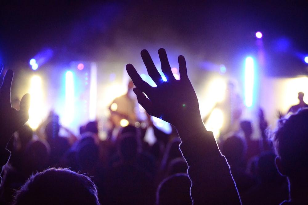 person's rai\sing hand