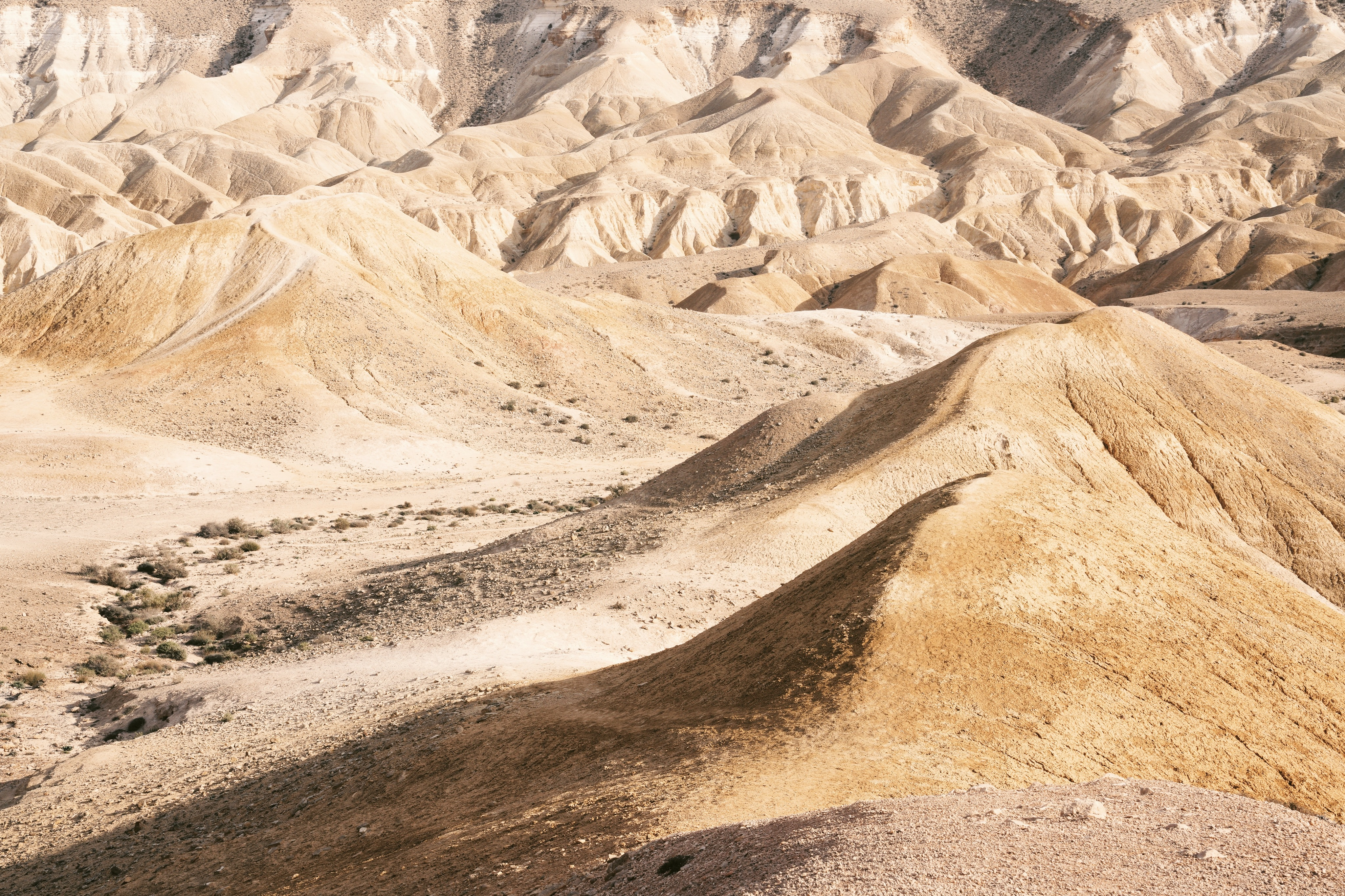 Arid sand dunes form peaks in the desert of Yeruham