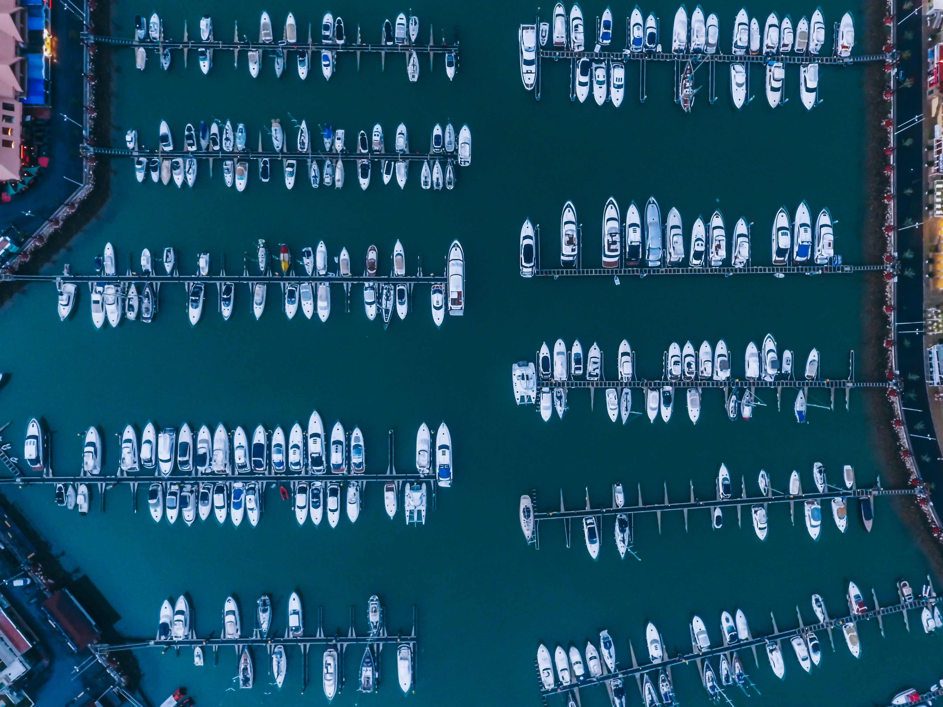 white boats on body of water at daytime