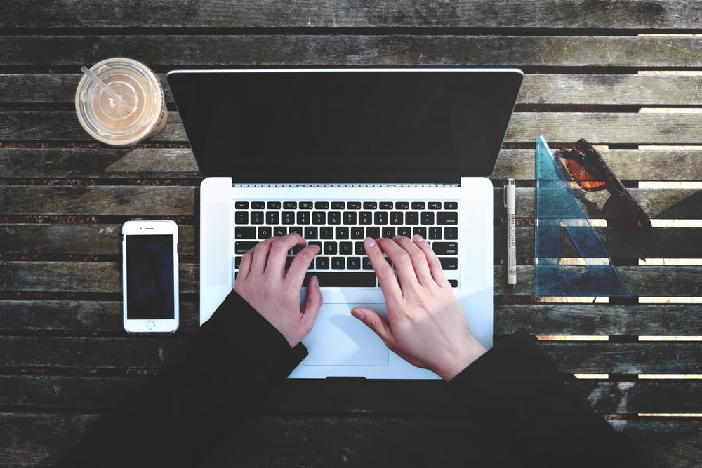 flat-lay photography of person about to use laptop computer