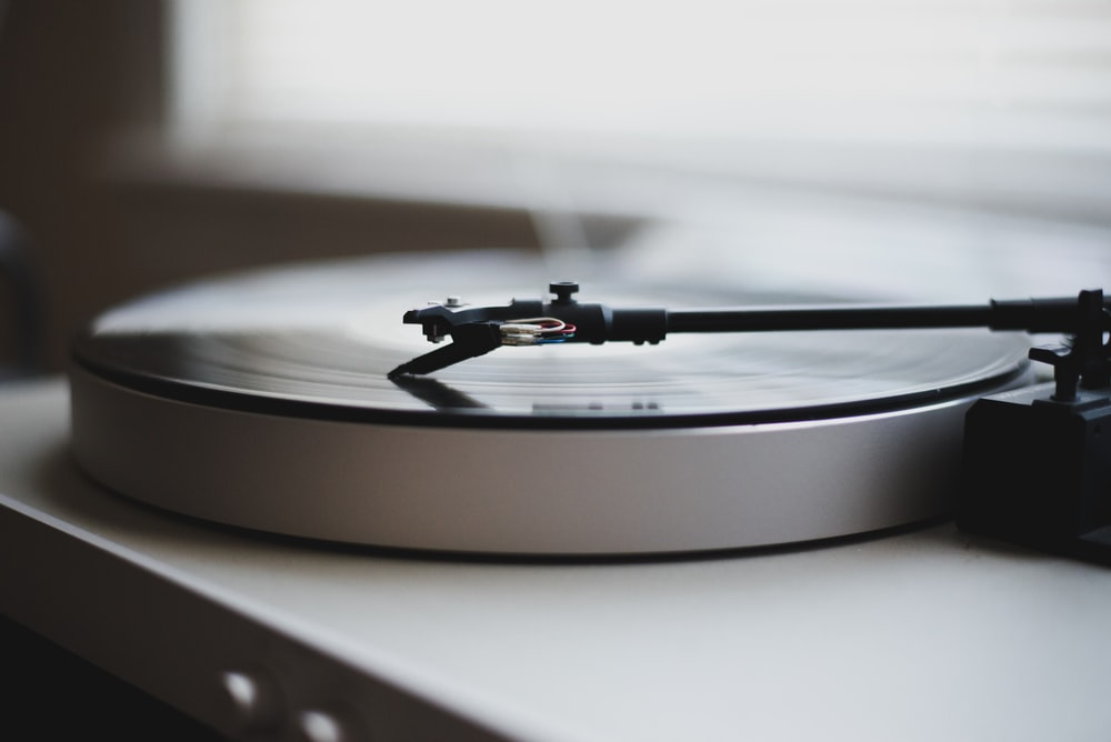 tilt shift lens photography of gray and black turntable