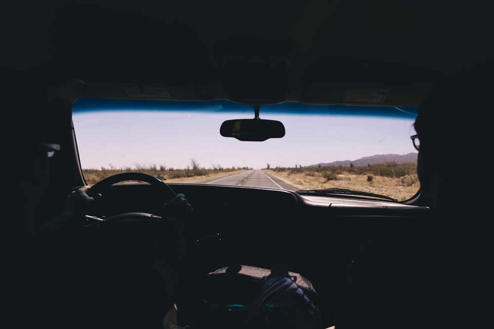 silhouette of person driving inside car