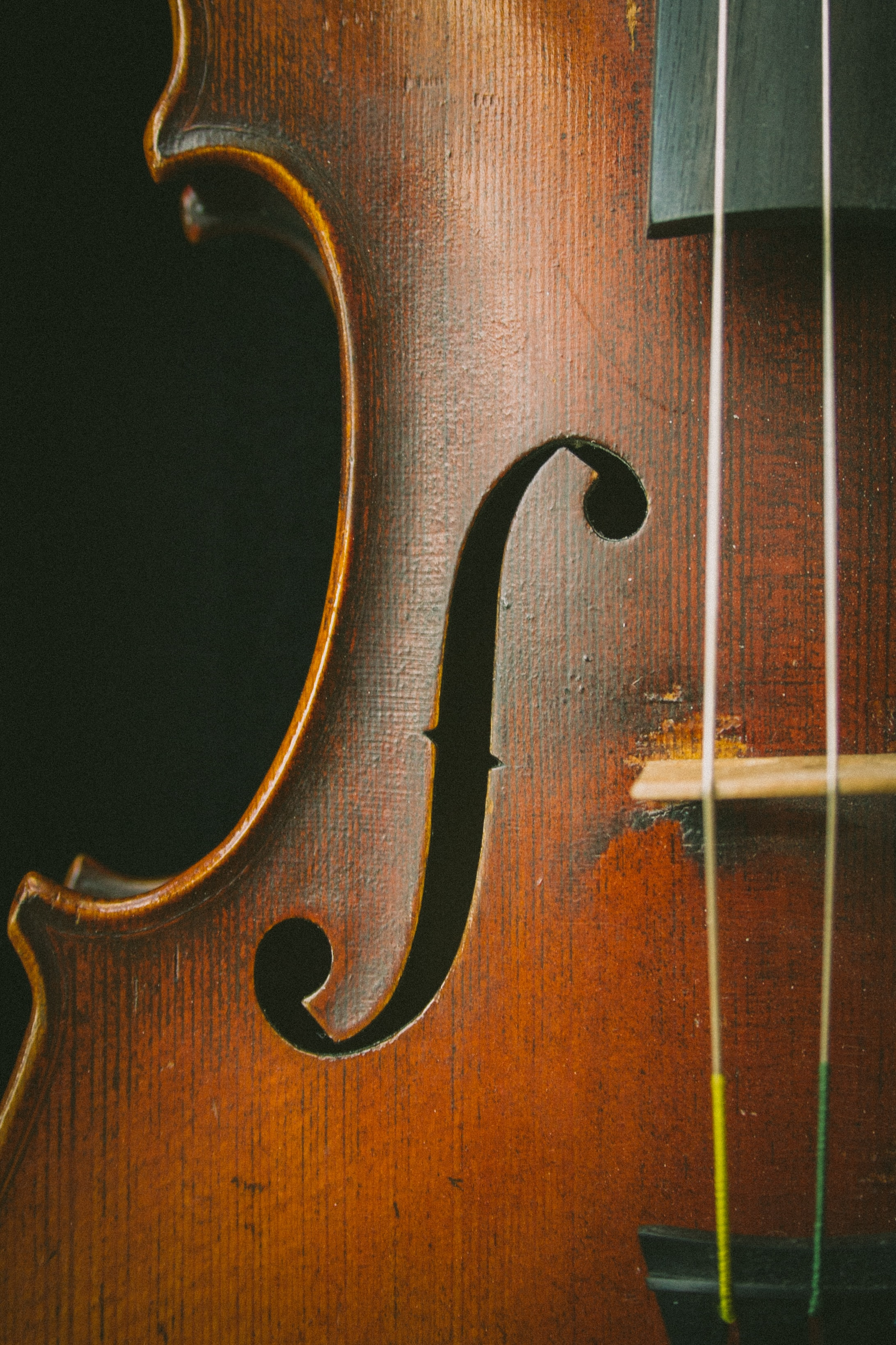 A close-up of the side of an old cello