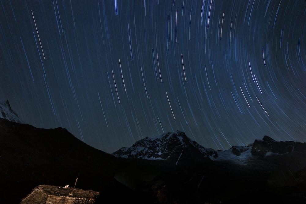 mountains under starry night