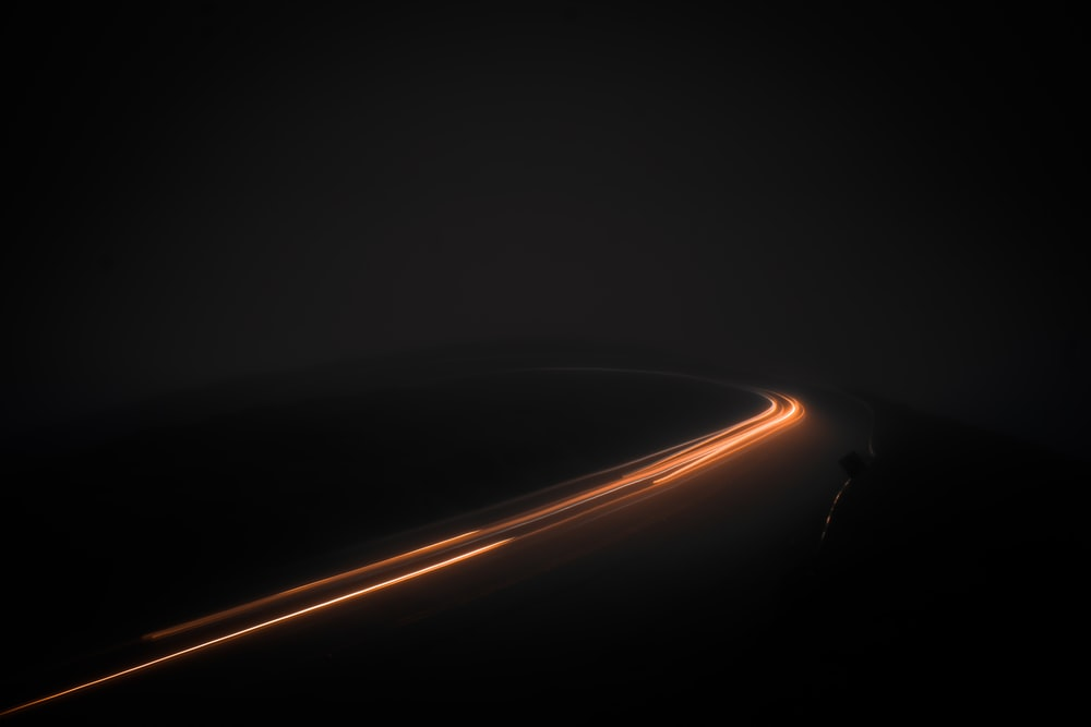 timelapse photography of vehicle on road