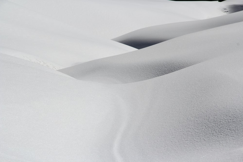 Small mountain slopes covered in white snow.