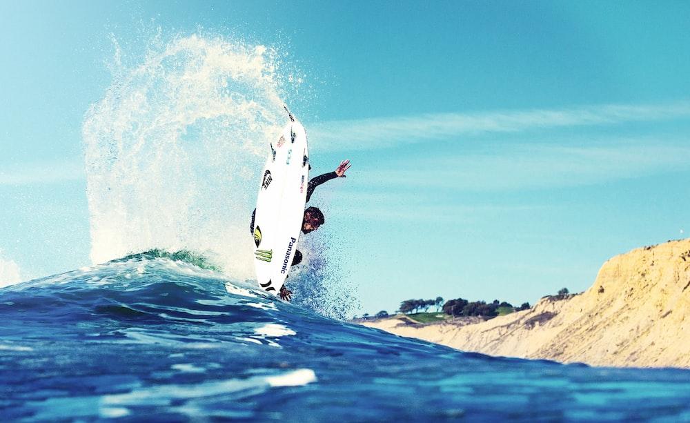 man surfing near land