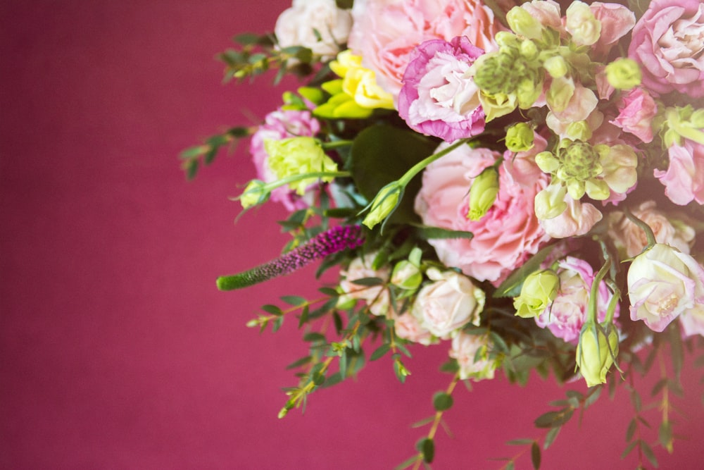 A large bouquet of roses, peonies and other smaller           flowers
