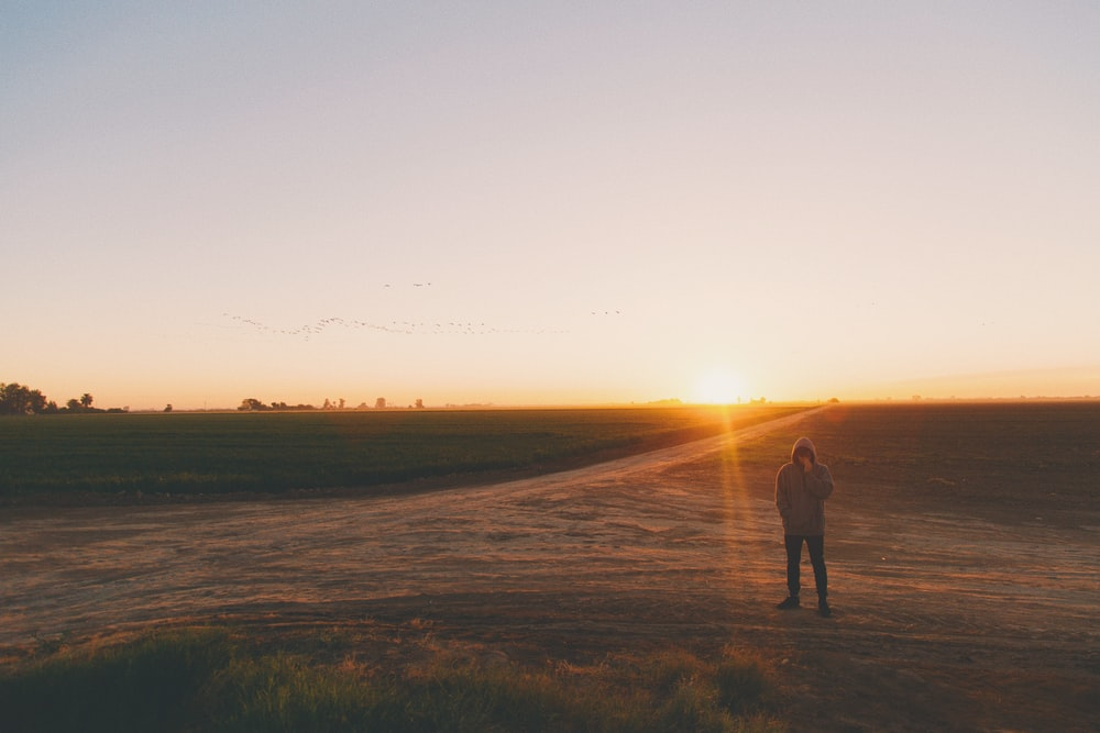 A man standing in Mexicali in desert during sunset