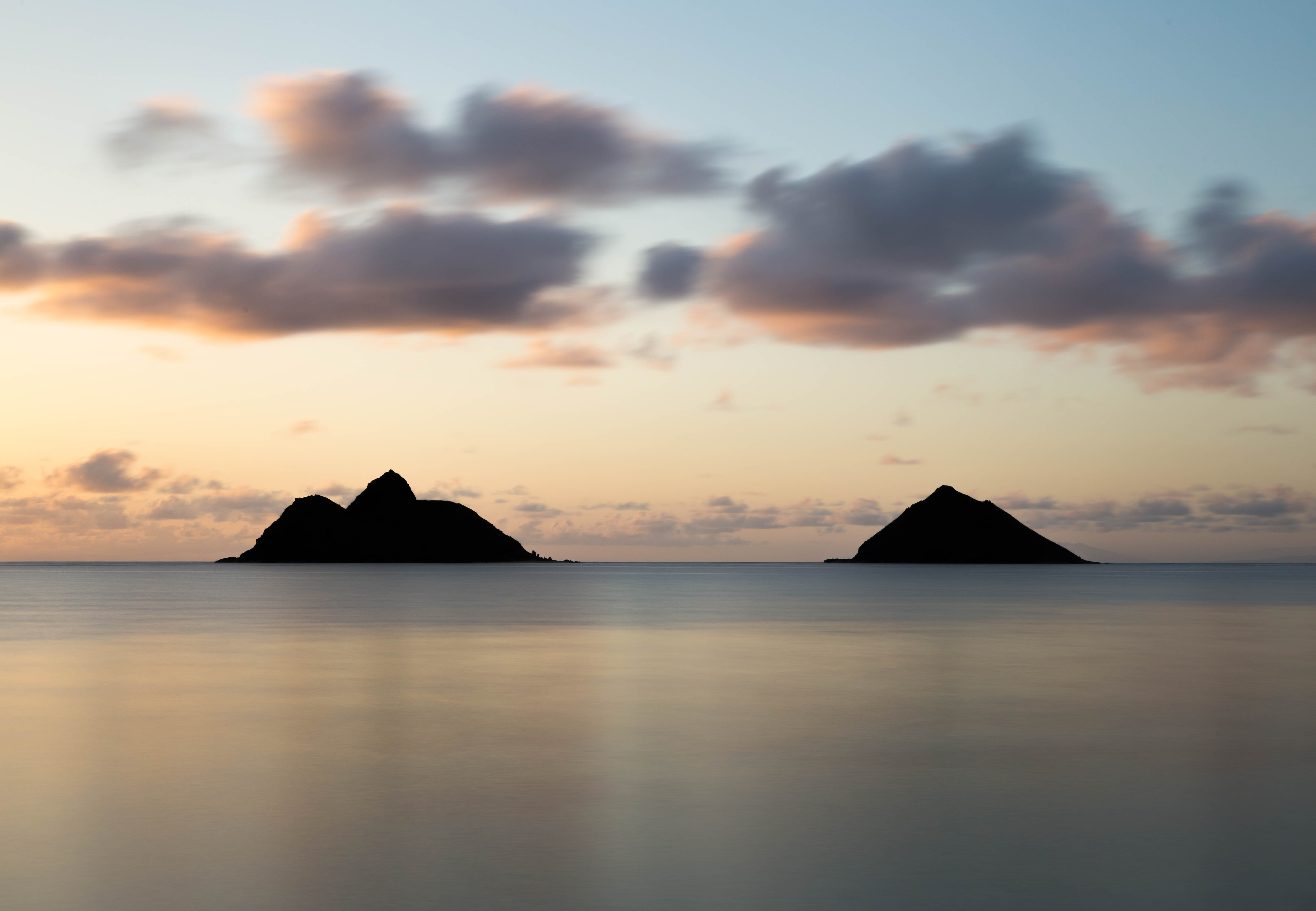 Two island silhouettes after the sunset at Lanikai Beach