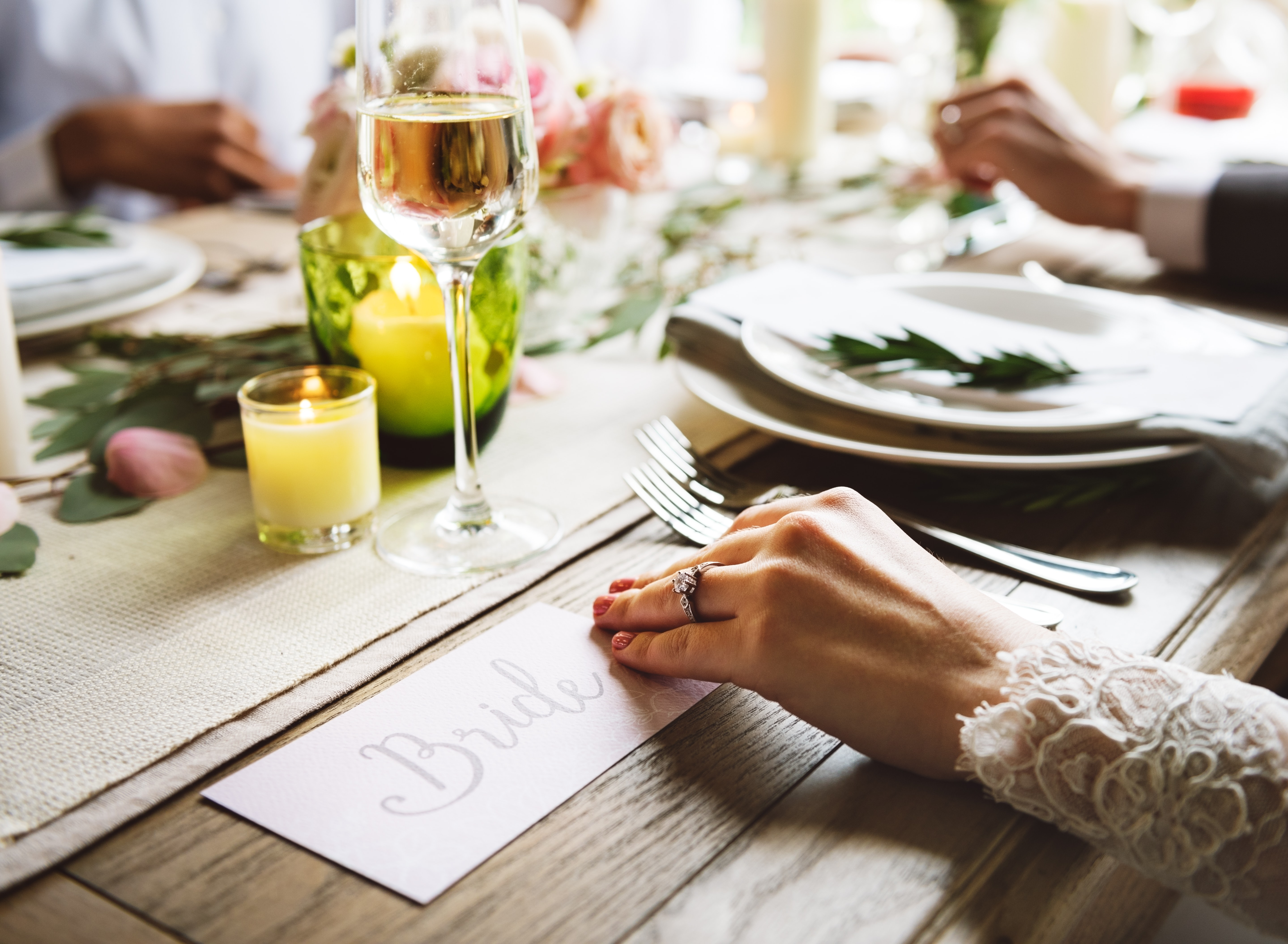 bride hand on wooden table