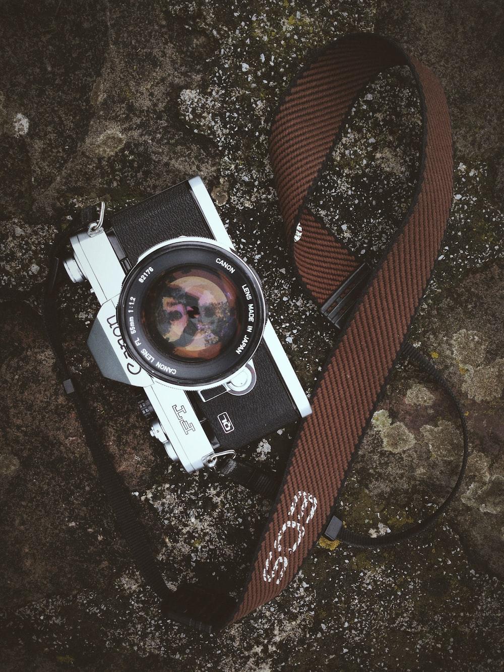 black and gray Canon camera
