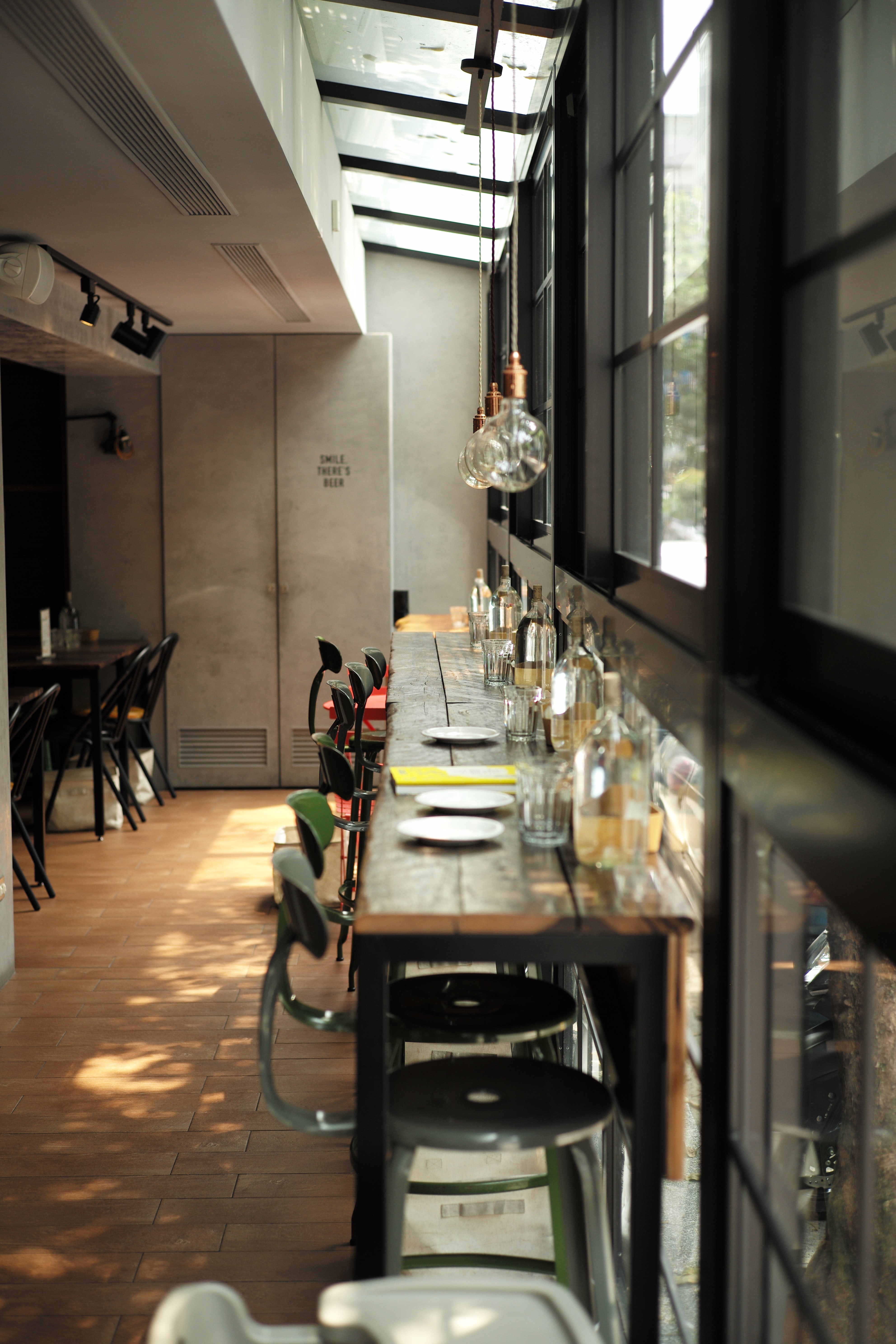 photograph of dining table arrangement with sphere pendant lamps