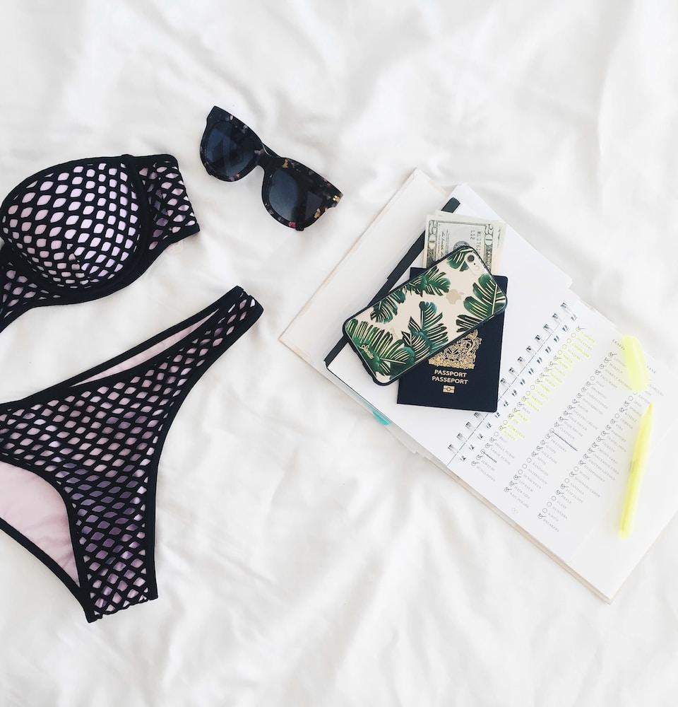 travelling women black bikini sunglasses passport